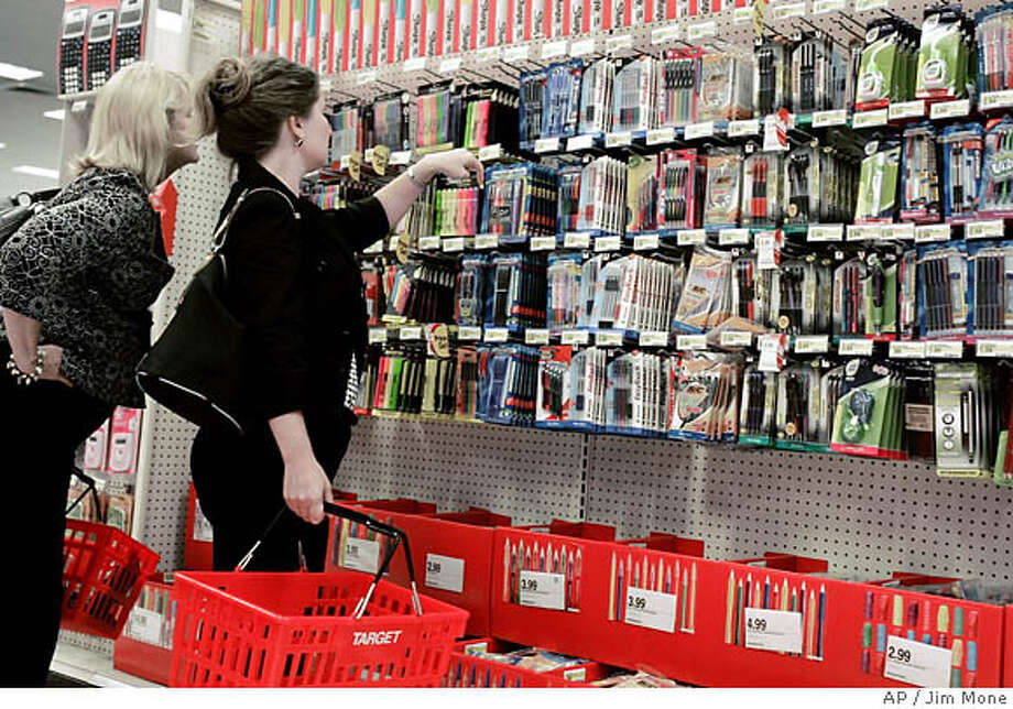 Target shoppers in Minneapolis cruise the school supplies aisle. The average family will spend $527.08 this year on back-to-school purchases, more than last year. Associated Press photo by Jim Mone