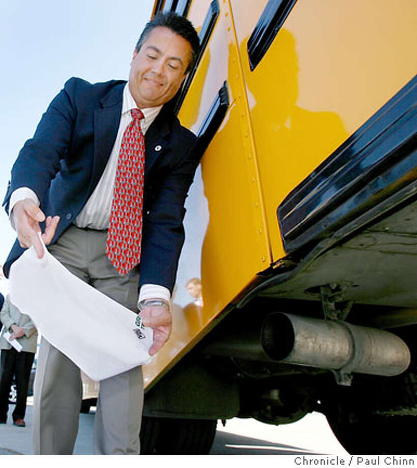 Wayne Nastri, regional adminstrator with the Environmental Protection Agency, holds a white handkerchief to the exhaust pipe of a school bus to demonstrate a cleaner burning diesel fuel in Sacramento, Calif. on Tuesday, August 22, 2006. On September 1, all California retailers are required to begin selling the ultra low sulfur diesel fuel which will reduce the amount of particulates released into the air. PAUL CHINN/The Chronicle  **Wayne Nastri  (EDS NOTE: Additional cutline info can be obtained at www.clean-diesel.org or www.wspa.org) Photo: PAUL CHINN