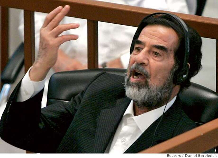Former Iraqi leader Saddam Hussein addresses the court on the second day of his trial, for genocide against Kurds in the 1980s, in Baghdad August 22, 2006. The trial of Saddam and six co-defendants resumed on Tuesday. Saddam faces charges of genocide after the killing of tens of thousands of Kurdish villagers in a campaign, codenamed Anfal -- Spoils of War -- that devastated northern Iraq in 1988. REUTERS/Daniel Berehulak/Pool (IRAQ) 0 Photo: POOL