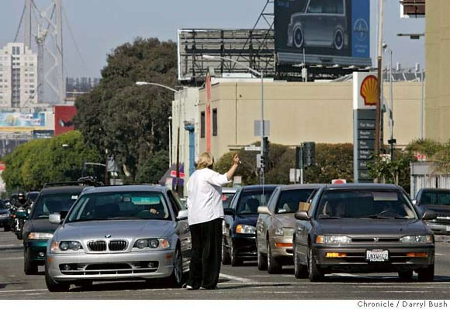 crashsites23_0004_db.JPG  A pedestrian stops in the crosswalk to wave at cars stopped on Harrison Street at Ninth Street, South of Market, where the most injury accidents occurred last year in San Francisco, CA on Tuesday, August 22, 2006. 8/22/06  Darryl Bush / The Chronicle ** (cq) MANDATORY CREDIT FOR PHOTOG AND SF CHRONICLE/ -MAGS OUT Photo: Darryl Bush