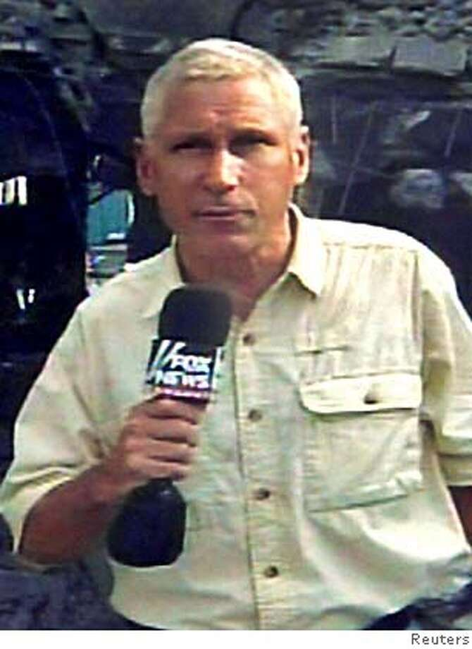 American Fox News Channel reporter Steve Centanni of the U.S., who was kidnapped by Palestinian gunmen on Monday in Gaza, is seen in this handout photo released August 16, 2006. Palestinian gunmen kidnapped two foreign journalists working for the Fox News Channel in Gaza on Monday, a witness and the U.S. television network said. NO ARCHIVES REUTERS/Handout (GAZA) 0 Photo: HO