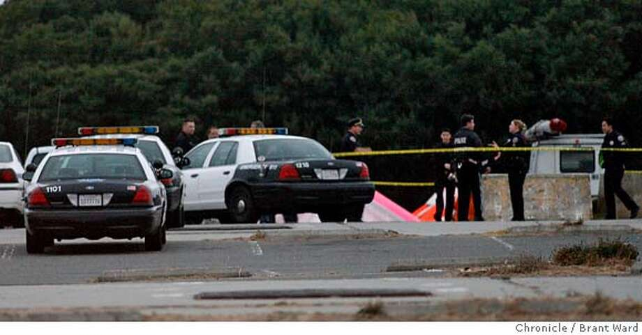 shooting136.jpg  Over a dozen SFPD squad cars converge on the hand-glider area where the shooting took place.  At San Francisco's Fort Funston a shooting took place Monday when a man opened fire on some hang-gliders. Rico Tecsom of Daly City witnessed the shooting.  {Brant Ward/The Chronicle} 8/21/06 MANDATORY CREDIT FOR PHOTOGRAPHER AND SAN FRANCISCO CHRONICLE/ -MAGS OUT Photo: Brant Ward