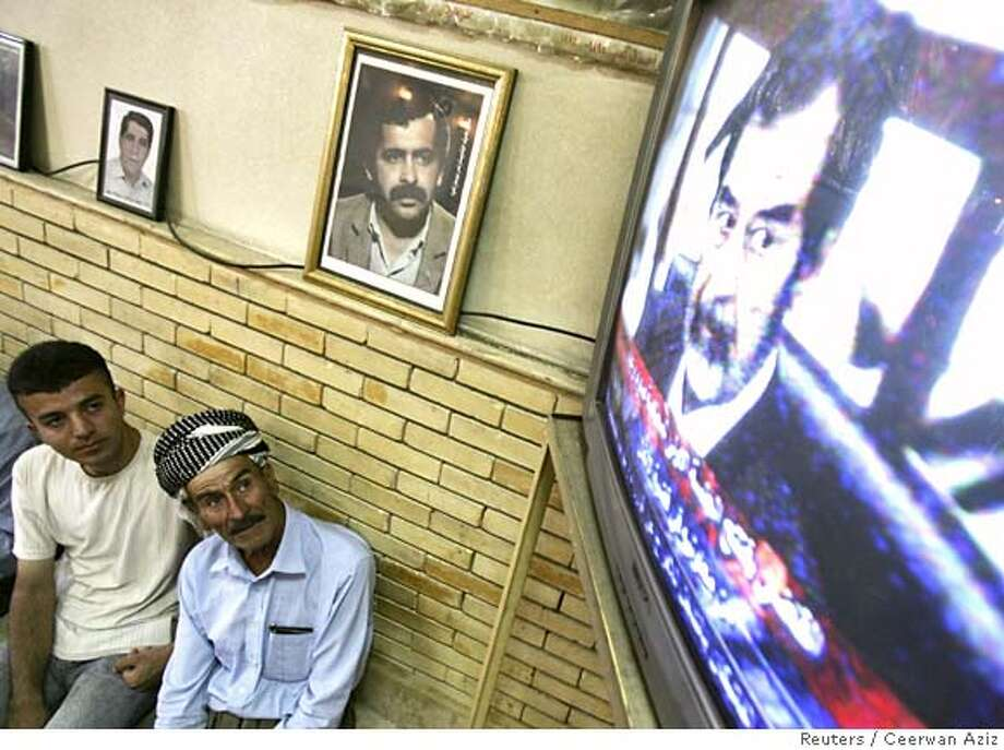 Residents watch the trial of former Iraqi leader Saddam Hussein on television at a coffee shop in Sulaimaniya, north of Iraq, August 21, 2006. Saddam Hussein refused to plead as he and six former army commanders went on trial in Baghdad on Monday for the killing of tens of thousands of Kurdish villagers in northern Iraq in the 1980s. REUTERS/Ceerwan Aziz (IRAQ) 0 Photo: CEERWAN AZIZ