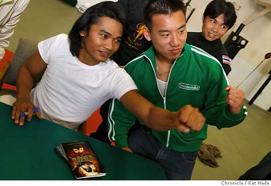 JAA05_095_KW_.jpg  On Wednesday August 16, 2006 (L to R) actor/martial artist Tony Jaa, poses with fan Victor Chan from San Francisco while one of his sparing partners, Chavalit Chaonoi looks on after giving a martial arts demonstration for fans at Team USA Kai Muay in San Francisco the day before his first big American Release film, The Protector.  Kat Wade/The Chronicle **Tony Jaa, Victor Chan and Chavalit Chaonoi (Subject) cq Mandatory Credit for San Francisco Chronicle and photographer, Kat Wade, Mags out Photo: Kat Wade