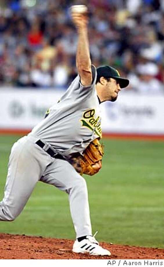 Oakland Athletic's pitcher Dan Haren delivers a pitch against the Toronto Blue Jays during sixth inning AL action in Toronto Monday, Aug. 21, 2006. The Athletics beat the Blue Jays 12-10. (AP PHOTO/CP, Aaron Harris) Photo: AARON HARRIS
