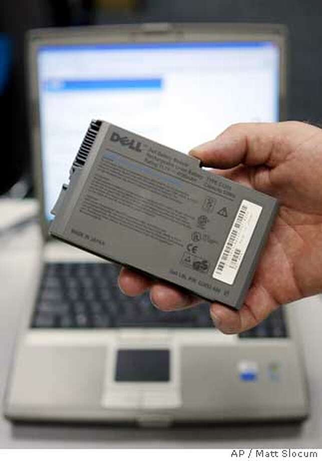 A recalled Dell notebook computer battery is shown Tuesday, Aug. 15, 2006, in Farmers Branch, Texas. In the largest electronics-related recall involving the Consumer Products Safety Commission, Dell Inc. agreed to replace 4.1 million notebook computer batteries made by Sony Corp. because they can burst into flames. (AP Photo/Matt Slocum) Photo: MATT SLOCUM
