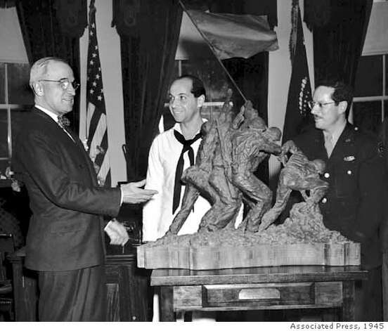 ** FILE ** President Truman is presented with a bronze statue modelled after Associated Press photographer Joe Rosenthal's photo of US marines raising the American flag on Mt. Suribachi, Iwo Jima, at the White House, in this June 4, 1945 file photo. From left, Truman, statue sculptor Felix de Weldon, and AP photographer Joe Rosenthal. De Weldon died Tuesday June 3, 2003 of natural causes. He was 96. (AP Photo/File)
