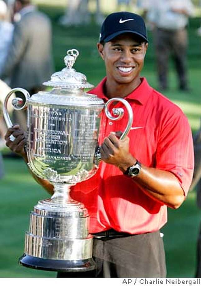 Tiger Woods holds the Wanamaker Trophy after winning the 88th PGA Championship golf tournament at Medinah Country Club Sunday, Aug. 20, 2006, in Medinah, Ill. (AP Photo/Charlie Neibergall) Photo: CHARLIE NEIBERGALL