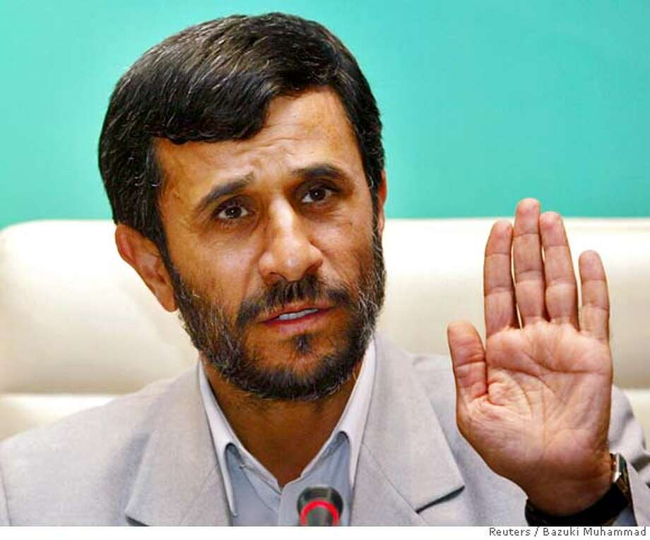 "Iranian President Mahmoud Ahmadinejad speaks during a news conference after the ""Meeting of Friends of the Chair of the 10th Islamic Summit Conference"" in Putrajaya outside Kuala Lumpur, August 3, 2006. Ahmadinejad and other leaders from the Islamic world demanded a halt on Thursday to Israeli attacks on Lebanon and Gaza and weighed inclusion of Muslim forces in a future peacekeeping operation. REUTERS/Bazuki Muhammad (MALAYSIA) 0 Photo: BAZUKI MUHAMMAD"