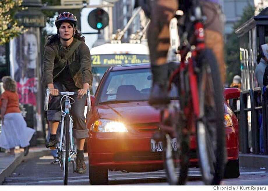 Bike commuters using the bike lanes on Market street.they cross 5th street . KURT ROGERS /THE CHRONICLE SAN FRANCISCO THE CHRONICLE  SFC BIKES21_0174_kr.jpg MANDATORY CREDIT FOR PHOTOG AND SF CHRONICLE / -MAGS OUT Photo: KURT ROGERS /THE CHRONICLE