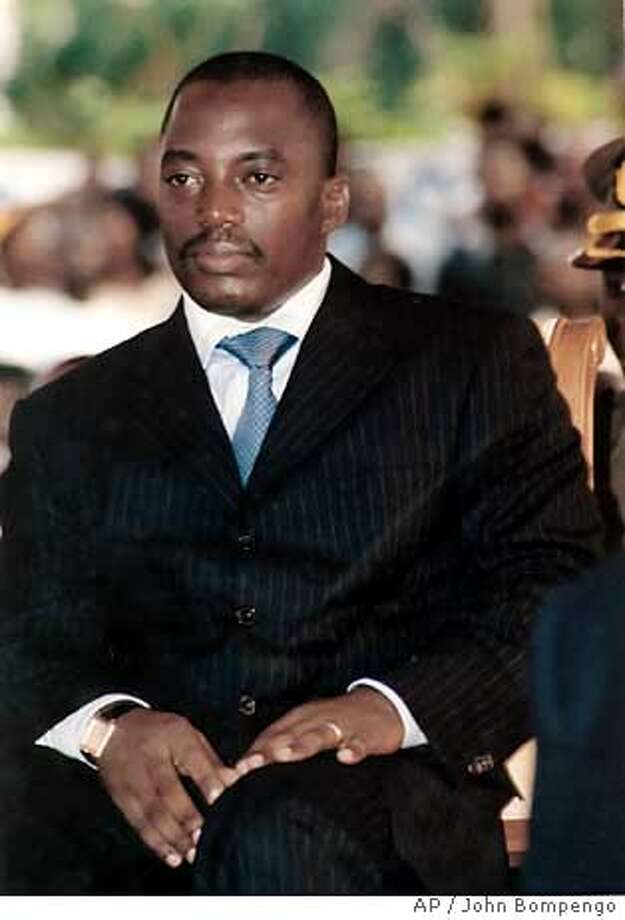 Congolese President Joseph Kabila attends a meeting of supporters of his election campaign at the Grand Hotel in Kinshasa, Congo Saturday, June 24, 2006. With Congo's 32 other presidential candidates given only four weeks to campaign in a country the size of Western Europe, incumbent President Kabila may well be one of the only recognizable names to millions of Congolese when they cast their ballots on July 30. (AP Photo/John Bompengo) Photo: JOHN BOMPENGO