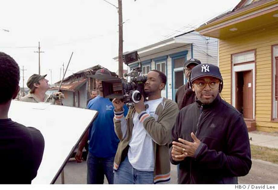 WHEN THE LEVEES BROKE: A REQUIEM IN FOUR ACTS: Spike Lee (right). photo: David Lee  Ran on: 08-21-2006  Spike Lee (right) with unidentified members of his crew filming on the streets of New Orleans. Photo: David Lee