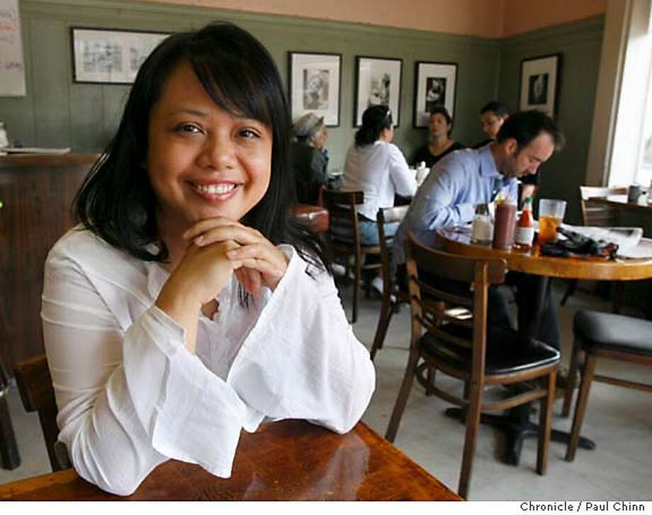 """Mia Ponce, a pastry chef at Chez Panisse, has breakfast at Tyger's coffee shop in San Francisco, Calif. on Tuesday, August 8, 2006. Ponce is profiled for the Chronicle's """"Cook's Night Out"""" feature.  PAUL CHINN/The Chronicle  **Mia Ponce MANDATORY CREDIT FOR PHOTOGRAPHER AND S.F. CHRONICLE/ - MAGS OUT Photo: PAUL CHINN"""