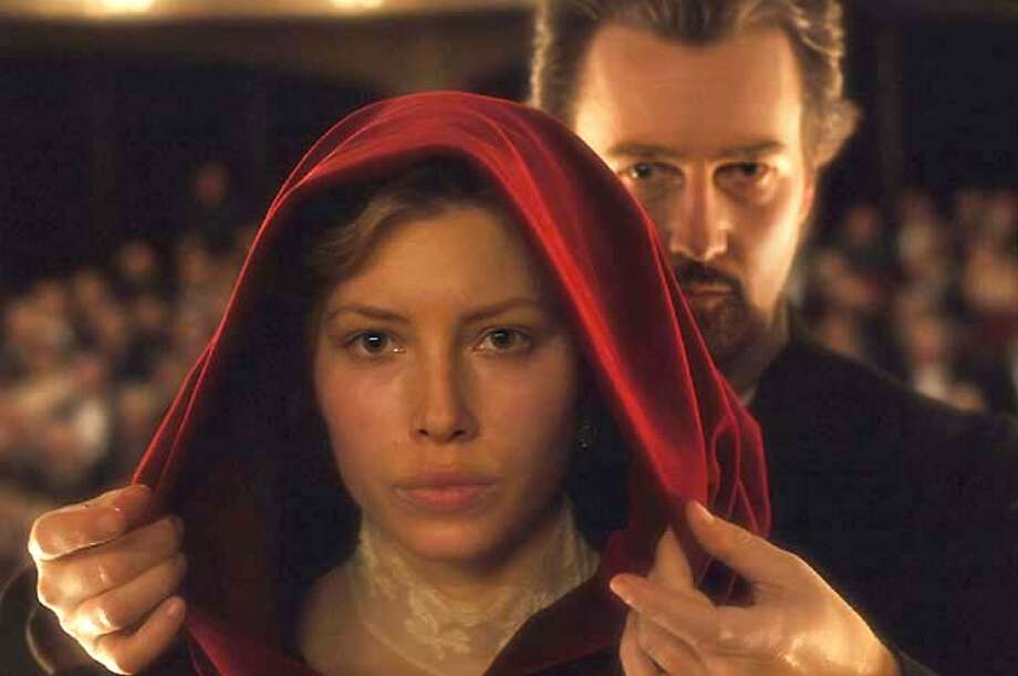 """In this photo provided by Yari Film Group, a magician in turn-of-the-century Vienna ( Edward Norton) who falls in love with a woman (Jessica Biel) well above his social standing. When she becomes engaged to a prince, the magician uses his powers to win her back and undermine the stability of the royal house of Vienna in """"the Illusionist."""" (AP Photo/Yari Film Group/Glen Wilson) Photo: GLEN WILSON"""