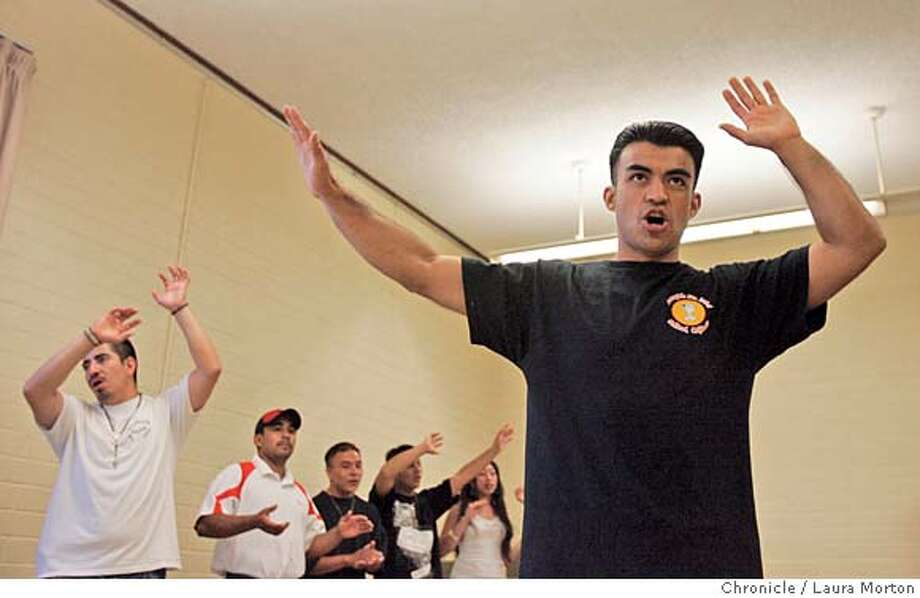 ja_gonzalez11057_lkm.JPG Miguel Angel Sandoval (left) participates in a song and dance group at St. Elizabeth's Church in Oakland, CA. Sandoval is a Jefferson Award winner who has worked to eradicate violence and crime in his neighborhood. Laura Morton/The Chronicle *** NOTE: photographer asked subject to write his name, which he wrote as Miguel Angel Sandoval. Writer has it as Miguel Angel Sandoval-Gonzalez in the photo request. MANDATORY CREDIT FOR PHOTOGRAPHER AND SAN FRANCISCO CHRONICLE/ -MAGS OUT Photo: Laura Morton