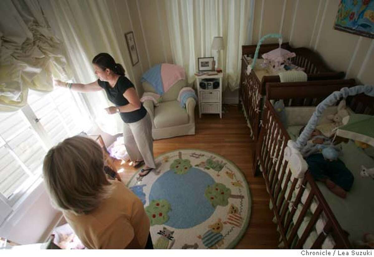 outsource_049_ls.JPG From left: Karen Kesti, sleep trainer; Jeanine Donohue; Liam Donohue (in crib). Jeanine Donohue pulls down the black out curtains in the twins' room after putting Liam in his crib for his second nap of the day. Sleep trainer Karen Kesti, who is revisiting 7month old twins, Liam and Clair and mom is Jeanine Donohue Wednesday, August 9, 2006. Photo by Lea Suzuki/The San Francisco Chronicle Photo taken on 8/9/06, in San Francisco, CA. **(themselves) cq. MANDATORY CREDIT FOR PHOTOG AND SAN FRANCISCO CHRONICLE/ -MAGS OUT