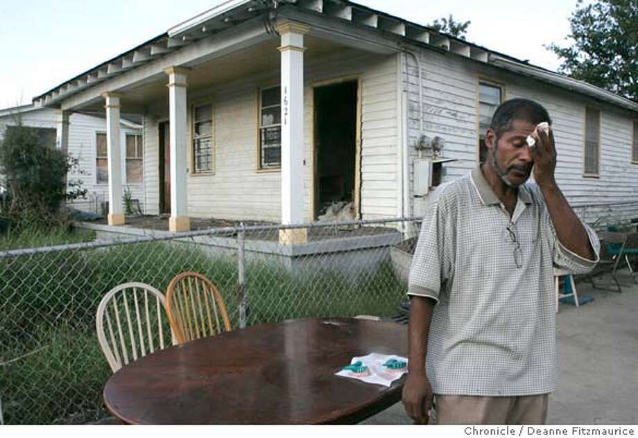 nola_0269_df.jpg  Albert wipes his brow in the 100 degree humid weather in his neighborhood after doing dental work on an aquaintance. Albert Bass, Jr. is one of the few residents of the Lower Ninth Ward who has remained after Hurricane Katrina. He is living in his gutted home with no electricity. He had to be rescued through his attic by a neighbor in a boat. Photographed in New Orleans on 8/17/06.  (Deanne Fitzmaurice/ The Chronicle) Mandatory credit for photographer and San Francisco Chronicle. /Magazines out. Photo: Deanne Fitzmaurice
