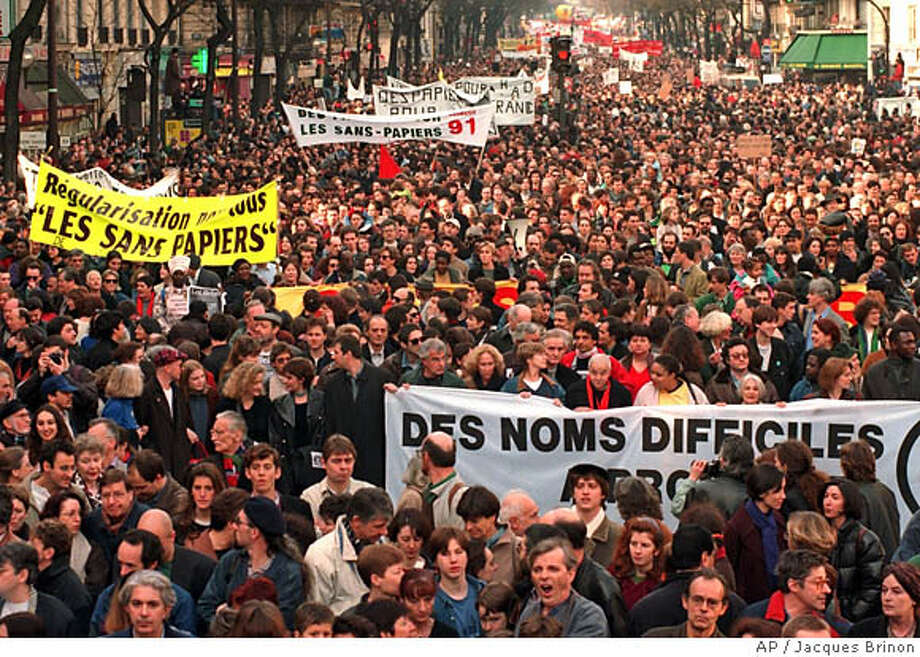 Protesters march in Paris to demonstrate against an immigration bill nearly 10 years ago. Such concerns have been common in Europe. Associated Press photo by Jaques Brinon
