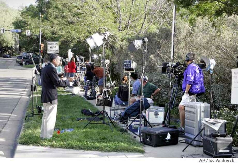 Television crews do there live morning broadcast Thursday, Aug. 17, 2006, from in front of the Justice Center in Boulder, Colo., where District Attorney Mary Lacy is scheduled to hold a news conference about the arrest of school teacher John Mark Karr, 41, who said publicly Thursday that he was with JonBenet Ramsey when she died. (AP Photo/Ed Andrieski) Photo: ED ANDRIESKI