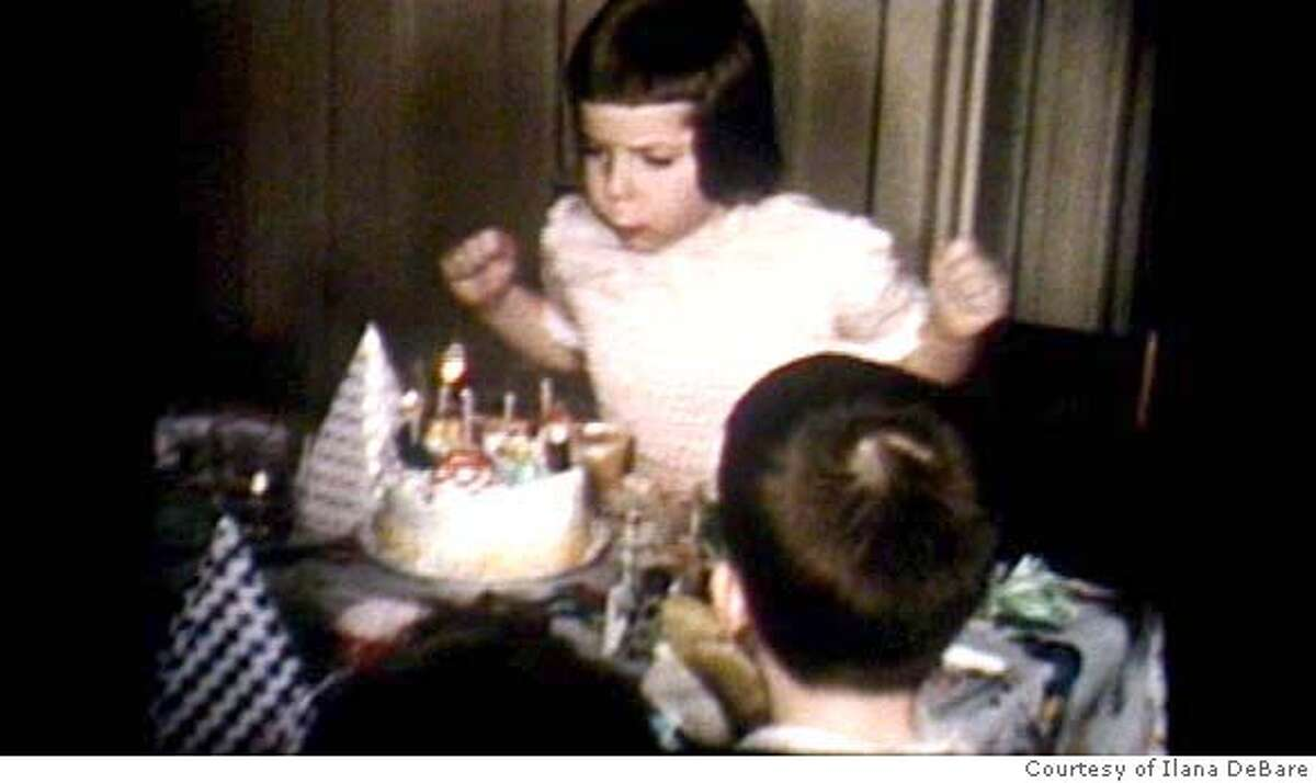 Ilana DeBare with cake on 5th birthday blowing out the candles. Courtesy Ilana DeBare