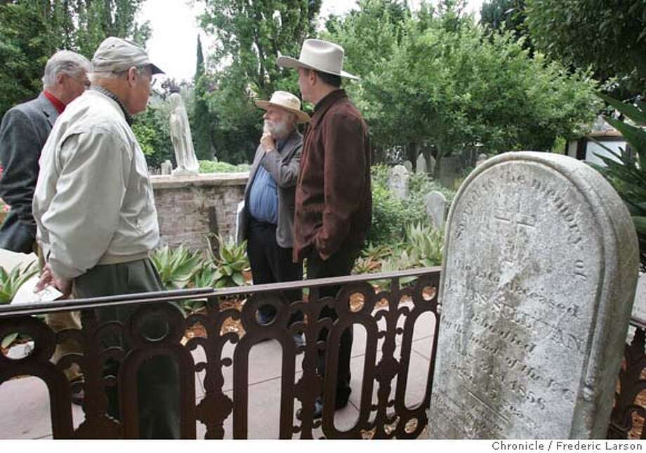 A small group of admires of the past gather at the Mission Dolores cemetery to commemorate the 150th anniversary of the end of the vigilante era in San Francisco. On this day day in 1856, thousands of armed men paraded through the streets of SF and then formally dissolved the second Committee of Vigilance. The group standing by James Sullivan grave site who was a boxer and also died in vigilante hands. Some said it was suicide or drink, but the cause is still a mystery. the vigilantes, now 8,000 song then took control of the city. 8/18/06  {Frederic Larson/The Chronicle} MANDATORY CREDIT FOR PHOTOGRAPHER AND SAN FRANCISCO CHRONICLE/ -MAGS OUT Photo: Frederic Larson