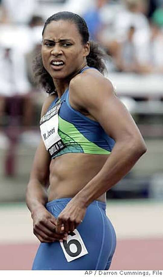 Marion Jones takes a look at her time of 11.17 in the prelims of the women's 100 meter run during the U.S. Outdoor Track & Filed Championships in Indianapolis, Friday, June 23, 2006. (AP Photo/Darron Cummings) Photo: DARRON CUMMINGS