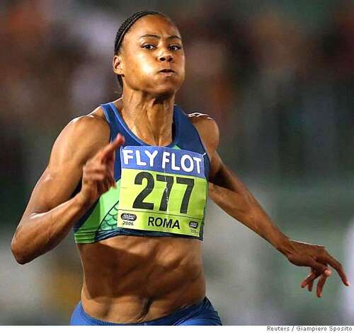 Marion Jones of the U.S. competes in the 100m women's race during the Golden Gala IAAF meeting at Rome's Olympic Stadium July 14, 2006. REUTERS/Giampiero Sposito (ITALY)  Ran on: 07-15-2006  Marion Jones lost but ran a 10.91 at the Golden Gala meet.  Ran on: 07-15-2006  Marion Jones lost but ran a 10.91 at the Golden Gala meet. Photo: GIAMPIERO SPOSITO