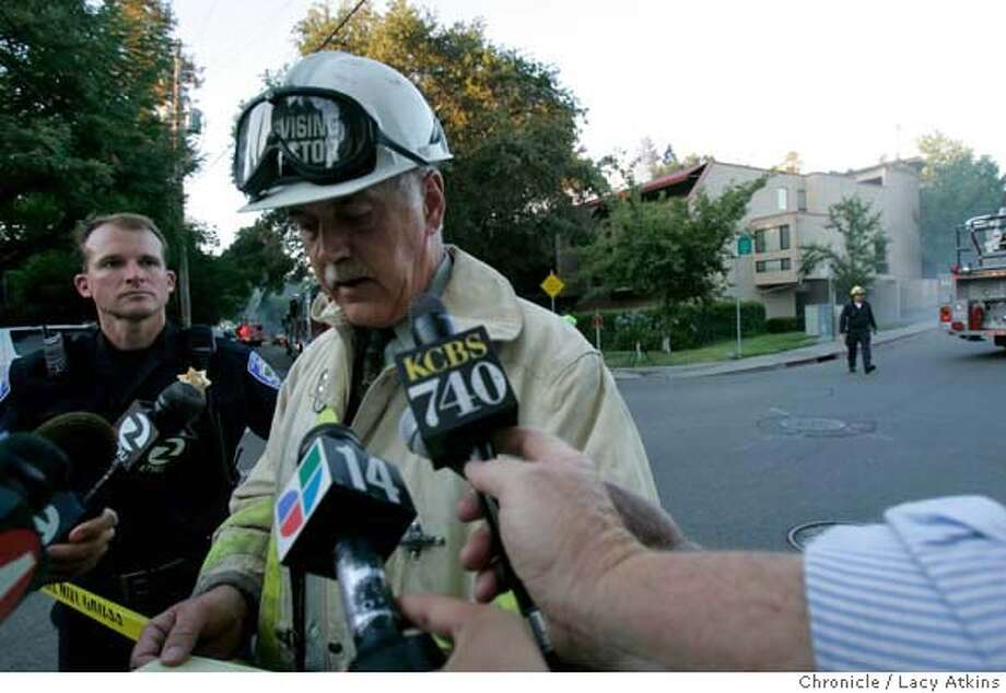 Robert Davis of the Contra Costa fire department briefs the press regarding a four alarm fire that broke out Thursday afternoon, Aug. 17, 2006, in a 38 unit complex Broadway Plaza apartments in Walnut Creek, Ca. Eight units were heavily damaged causing approximately 2 million dollars in damage. (Lacy Atkins/The Chronicle) Photo: Lacy Atkins