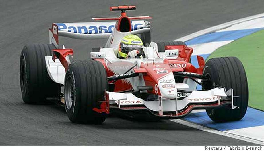 Toyota's Ralf Schumacher of Germany speeds through the Motodrom during the first free practice session of the German Formula One Grand Prix in Hockenheim July 28, 2006. The German Grand Prix will take place on Sunday, July 30. REUTERS/Fabrizio Bensch (GERMANY) 0 Photo: FABRIZIO BENSCH