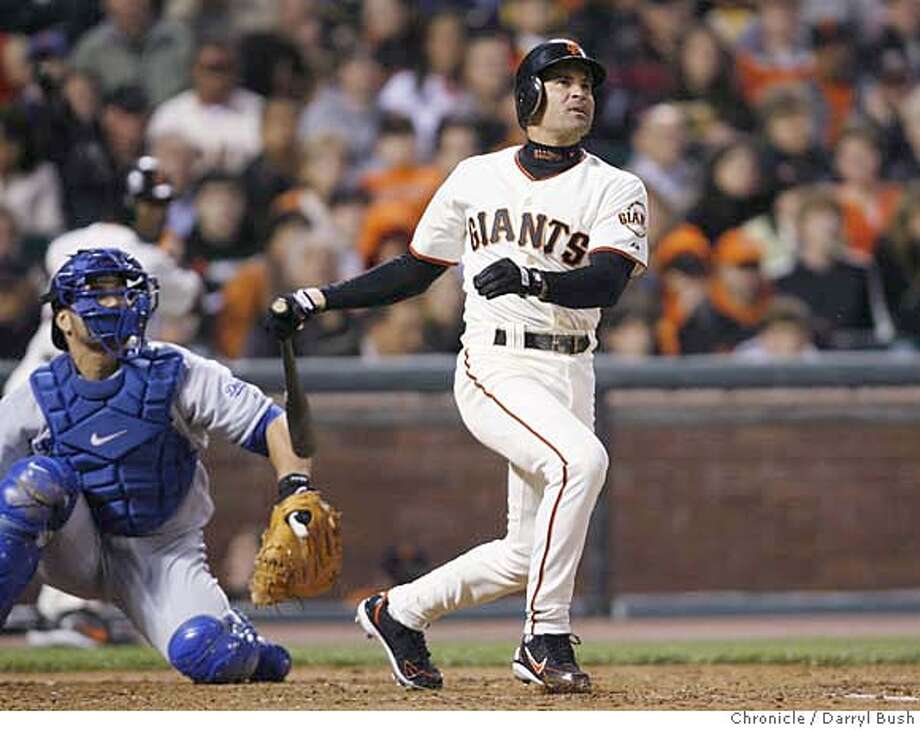 giants_0005_db.JPG  San Francisco Giants Omar Vizquel hits a two run homer in the 3rd inning vs. Los Angeles Dodgers at AT&T Park in San Francisco, CA on Friday, August 18, 2006. 8/18/06  Darryl Bush / The Chronicle ** roster (cq) Photo: Darryl Bush