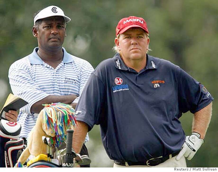 Vijay Singh of Fiji (L) and John Daly of the U.S. wait on the 17th tee in the second round of the 88th PGA Championship golf tournament in Medinah, Illinois, August 18, 2006. REUTERS/Matt Sullivan (UNITED STATES) 0 Photo: MATT SULLIVAN