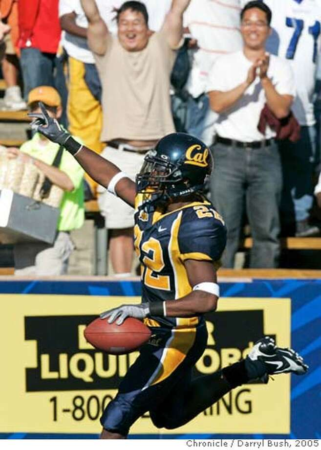 calfootball_014_db.jpg  California Golden Bears Tim Mixon celebrates after running for a punt return touchdown in the 4th qtr. as Illinois vs. Illinois at Memorial Stadium.  Event on 9/17/05 in Berkeley.  Darryl Bush / The Chronicle Ran on: 09-18-2005  Tim Mixon's 79-yard punt return for a TD kept Cal pointing in the right direction in a big fourth quarter. Ran on: 09-18-2005  Tim Mixon's 79-yard punt return for a TD kept Cal pointing in the right direction in a big fourth quarter. Ran on: 09-18-2005  Tim Mixon's 79-yard punt return for a TD kept Cal pointing in the right direction in a big fourth quarter. MANDATORY CREDIT FOR PHOTOG AND SF CHRONICLE/ -MAGS OUT Photo: Darryl Bush