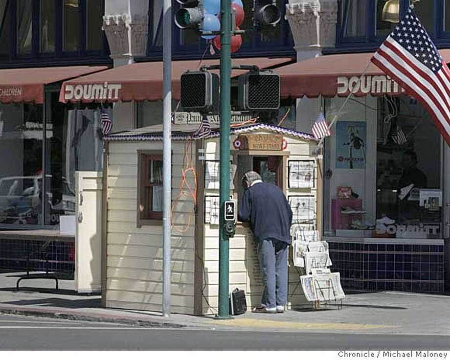 Paul's Newsstand in Alameda has been refurbished and was dedicated today. The historic newsstand first opened in 1934 when John Mulvany, who bought papers from Paul Manning every morning at the corner of Santa Clara Ave. and Park St., donated materials and labor to build the 5 X 5 foot newsstand for Manning who had polio was selling papers there out of his wheelchair. Manning ran it until his death in 1949. The newsstand became a major gathering place in WWII. NOTE: THE CHRONICLE pays the annual business license fee for the newsstand, although there is no official owner of the structure.  Photo by Michael Maloney / San Francisco Chronicle on 8/17/06 in ALAMEDA,CA MANDATORY CREDIT FOR PHOTOG AND SF CHRONICLE/ -MAGS OUT Photo: Michael Maloney