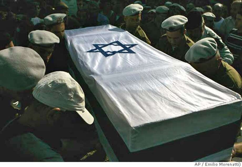 Israeli army soldiers carry for burial the flag-covered coffin of army soldier David Amar during his funeral in the northern Israel town of Kiryat Shmona Wednesday Aug. 16, 2006. Amar was killed Sunday during fighting with Hezbollah guerrillas in southern Lebanon. Israel will halt the withdrawal of its troops from southern Lebanon if the Lebanese army doesn't deploy its troops there, Israel's military chief said Wednesday.(AP Photo/Emilio Morenatti) Photo: EMILIO MORENATTI