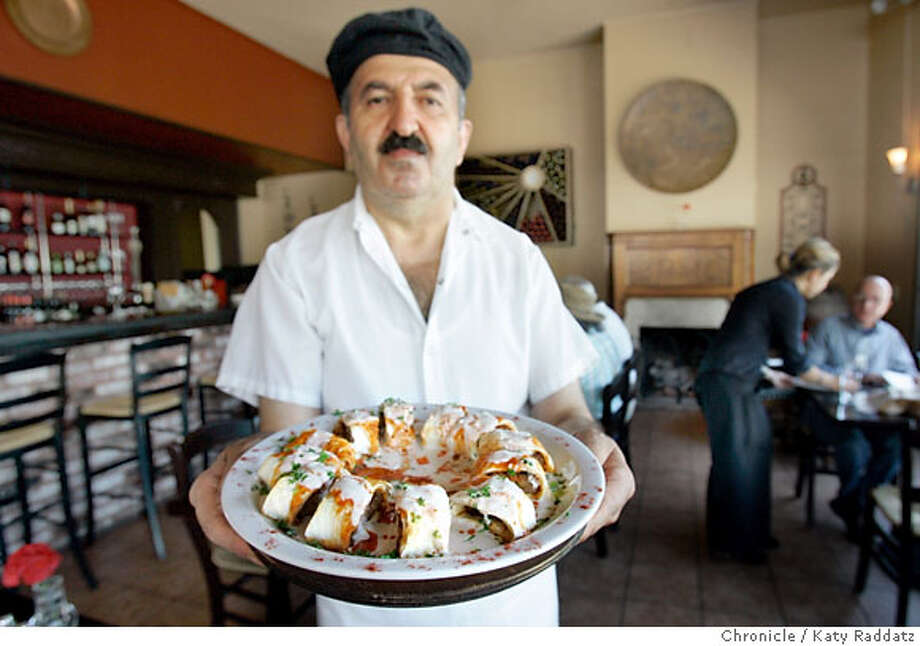 BARGAIN17_TROYA_015_RAD.jpg  SHOWN: Chef Mehmet Vural holds a lovely plate of Beyti, which is ground lamp in lavash bread roulade, topped with tomato sauce, garlic yogurt, and melted paprika butter. Troya is a Turkish restaurant in San Francisco on Clement St. at 5th St. These photos shot in San Francisco, CA. on Tuesday August 8, 2006.  (Katy Raddatz/The S.F.Chronicle)  **Mehmet Vural, Beyti, Troya Photo: Katy Raddatz