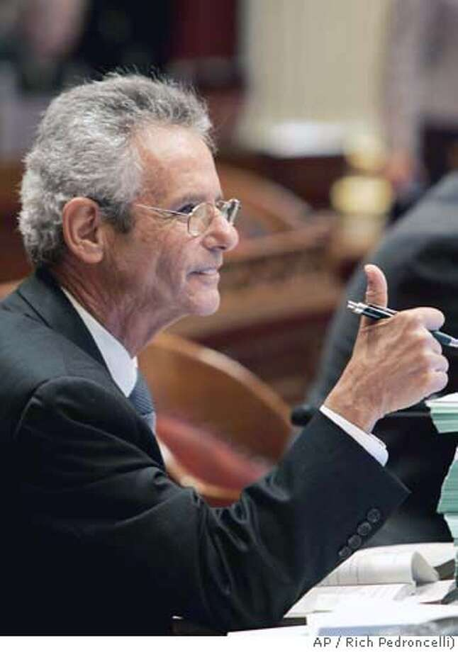 State Sen. Alan Lowenthal, D-Long Beach, gives thumbs up after his redistricting measure was approved by the state Senate at the Capitol in Sacramento, Calif., Wednesday, Aug. 16, 2006. The measure, which would allow voting districts to be redrawn by an 11-member panel instead of lawmakers, was sent to the Assembly for its consideration. (AP Photo/Rich Pedroncelli) Photo: RICH PEDRONCELLI
