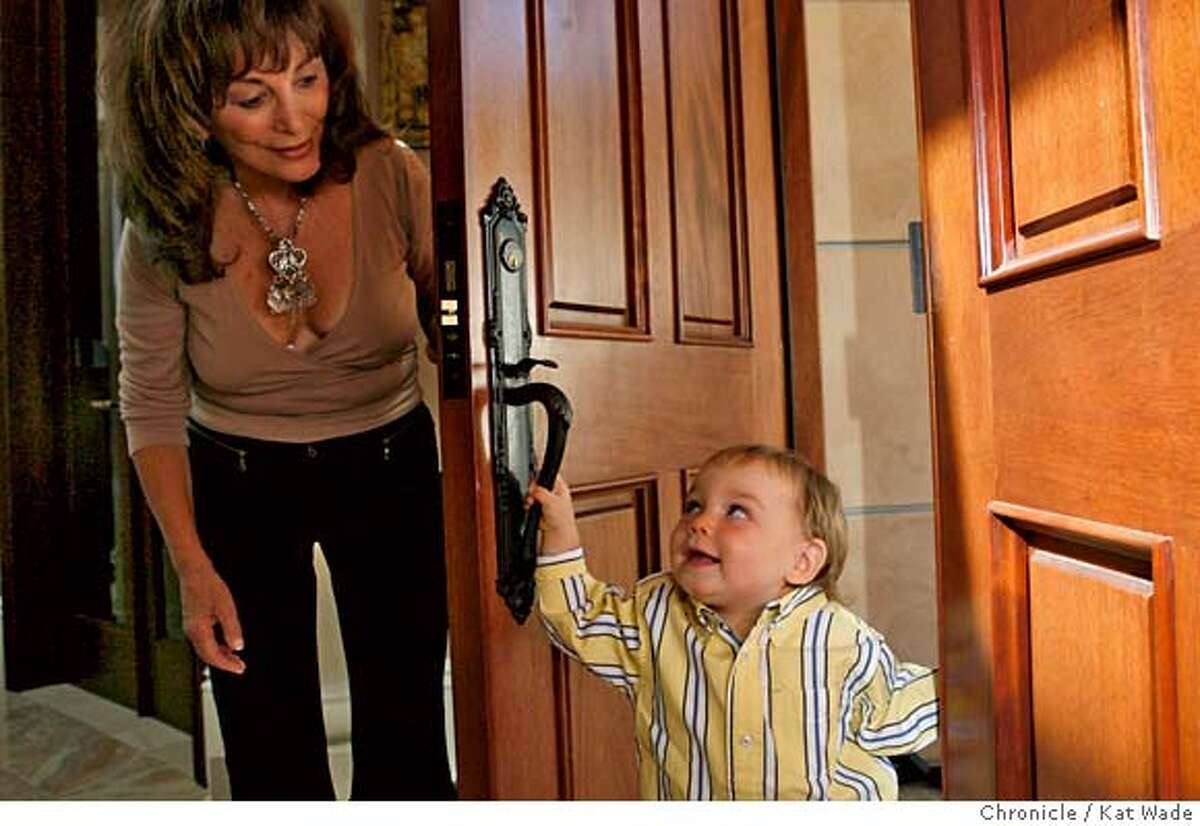 QUARRY_134_KW_.jpg Kit Cole, 65, who already raised ten children, adopted her great-grandnephew, when he was one month-old. On Wednesday August 16, 2006 Coles plays with her 18-month-old son Nathaniel