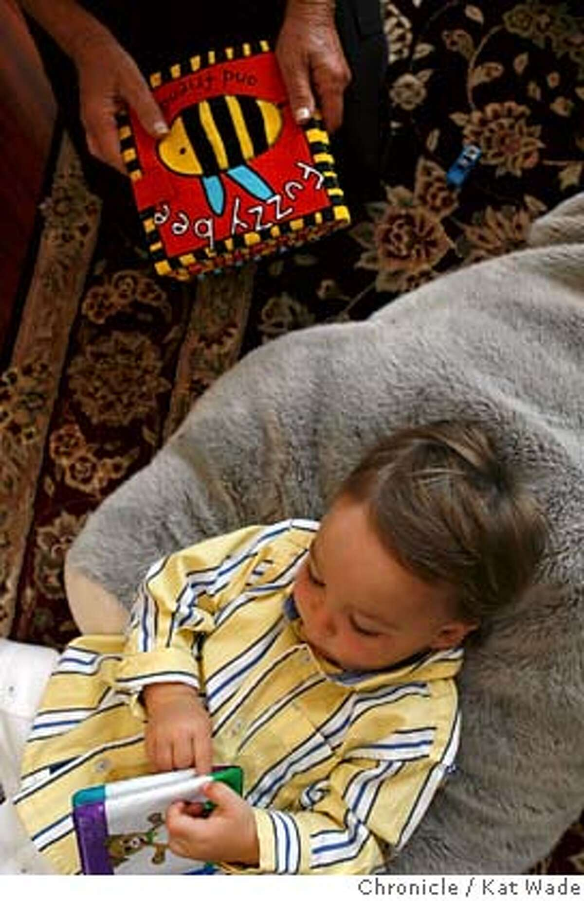 QUARRY_134_KW_.jpg On Wednesday August 16, 2006 (TOP) Kit Cole (HANDS ONLY) reads with her 18-month-old son Nathaniel