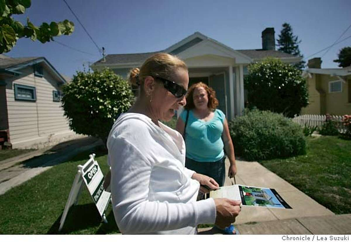homesales17_020_ls.JPG From left: Gail Bowman of Castro Valley and Athena Vercher of San Leandro in front of an open house in San Leandro. Buyers at an open house, a realor showing it and a couple looking over a model home which they've purchased and will be completed in October on Sunday August 13, 2006. Photo by Lea Suzuki/The San Francisco Chronicle Photo taken on 8/13/06, in Oakland, CA. **(themselves) cq. MANDATORY CREDIT FOR PHOTOG AND SAN FRANCISCO CHRONICLE/ -MAGS OUT