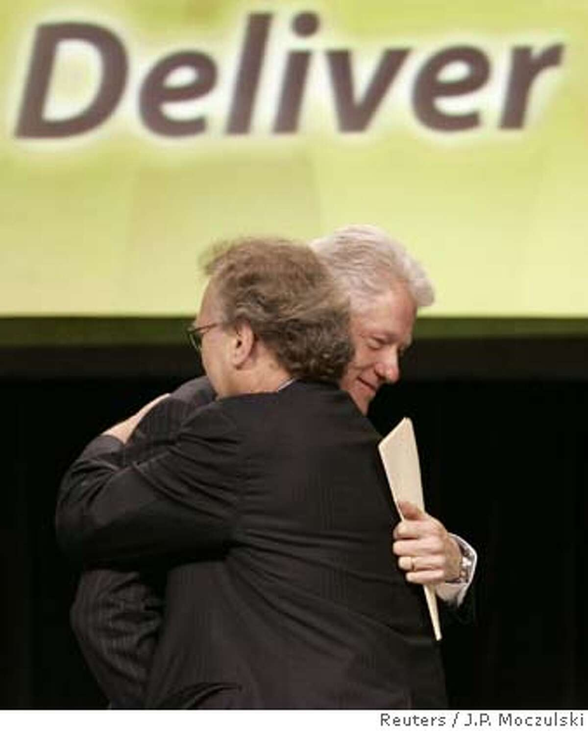 Former U.S. President Bill Clinton (R) hugs UN Special Envoy for AIDS/HIV in Africa Stephen Lewis (L) at the start of a panel discussion at the Sixteenth International AIDS conference in Toronto August 15, 2006. REUTERS/J.P. Moczulski (CANADA) 0