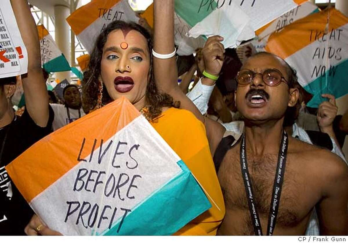 Protesters from the Quit India Movement demonstrate at the 16th World AIDS Conference in Toronto on Tuesday Aug. 15, 2006. The group is unhappy with multi-national drug company profits. (AP PHOTO/CP, Frank Gunn)