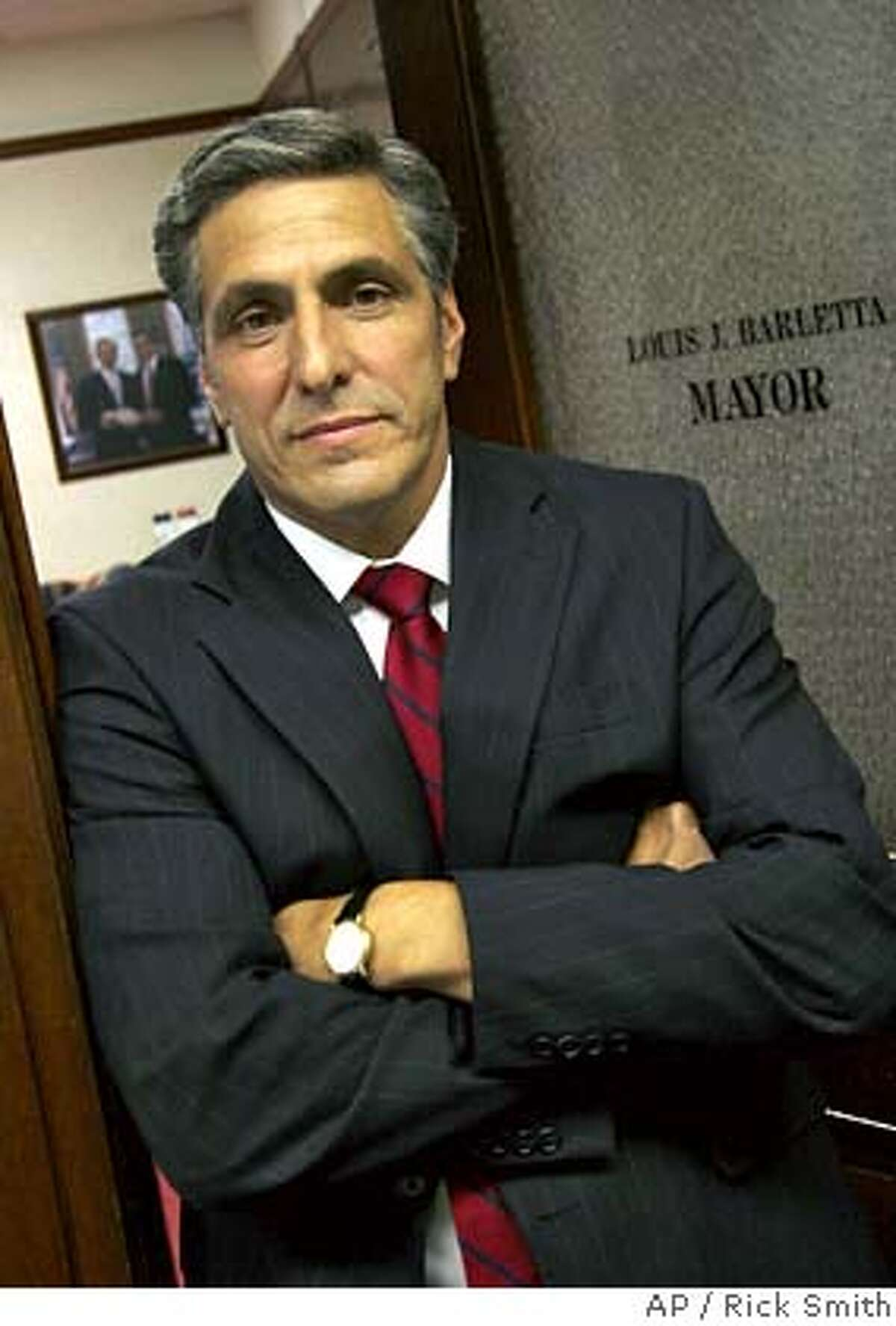 ** FILE ** Mayor Lou Barletta stands in his office June 14, 2006, in Hazleton, Pa. Hispanic groups sued Hazleton Tuesday, Aug. 15, 2006, over one of the toughest crackdowns on illegal immigrants by a U.S. city. (AP Photo/Rick Smith, File) JUNE 14, 2006 FILE PHOTO