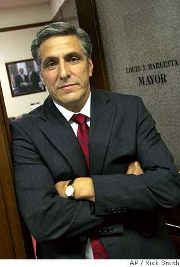 ** FILE ** Mayor Lou Barletta stands in his office June 14, 2006, in Hazleton, Pa. Hispanic groups sued Hazleton Tuesday, Aug. 15, 2006, over one of the toughest crackdowns on illegal immigrants by a U.S. city. (AP Photo/Rick Smith, File) JUNE 14, 2006 FILE PHOTO Photo: RICK SMITH
