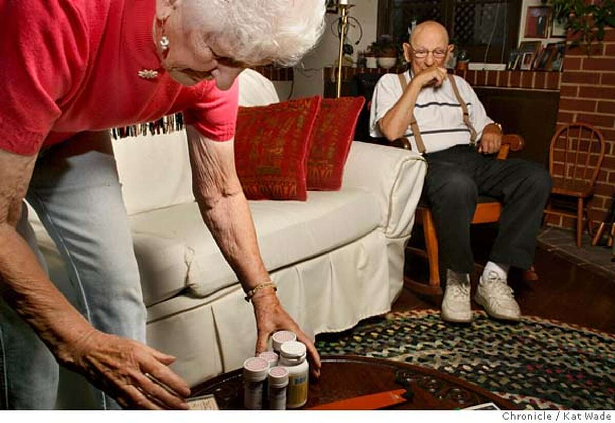 DOUGHNUTxx_012_KW_.jpg (L to R) Violet Grayson Lawton, 80, and her partner George Schultz, 96, pose in their Alameda homeThursday Aug 03, 2006. Lawton hit Medicare's gap in prescription drug coverage built into the new plan where she was covered until she reached $2,250.00', but coverage is cut off until she reaches $3,600.00. Lawtons prescriptions would have cost her $520.00 per month out-of-pocket, but with her doctors help she dropped one prescription and switched to generic and over-the-counter drugs bringing her personal monthly expenditure to $278.00 per month. Kat Wade/The Chronicle ** Violet Grayson Lawton, 80, and her partner George Schultz, 96 (Subjects) cq Mandatory Credit for San Francisco Chronicle and photographer, Kat Wade, Mags out