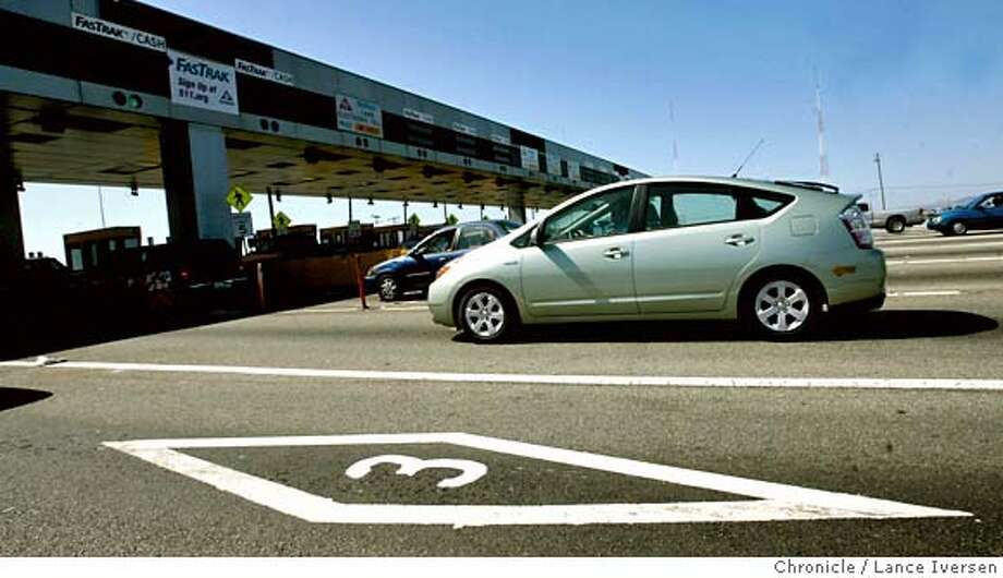 HYBRID_0086.JPG  A hybrid Toyota Prius uses one of two diamond lanes at the Bay Bridge Monday afternoon. Many hybrids have been purchased lately so drivers can take advantage of the diamond lanes. The State of California has announced that they have a limited number of stickers for Hybrid, and will soon run out. 8/14/06 in BERKELEY.By Lance Iversen/San Francisco Chronicle MANDATORY CREDIT PHOTOG AND SAN FRANCISCO CHRONICLE/ MAGS OUT Photo: By Lance Iversen