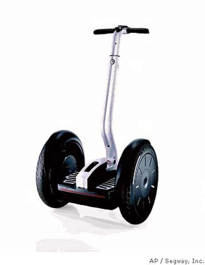 In an undated photo released by Segway, Inc. is the Segway i2 Personal Transporter. Although the electric, self-balancing Segway scooter never quite caught on with commuters the way its backers had predicted five years ago, the gizmo has found a growing market among law-enforcement agencies, with more than 100 departments around the world now signed on as customers and many others testing the device. (AP Photo/Segway, Inc.) PHOTO RELEASED BY SEGWAY, INC. ; Photo: HO