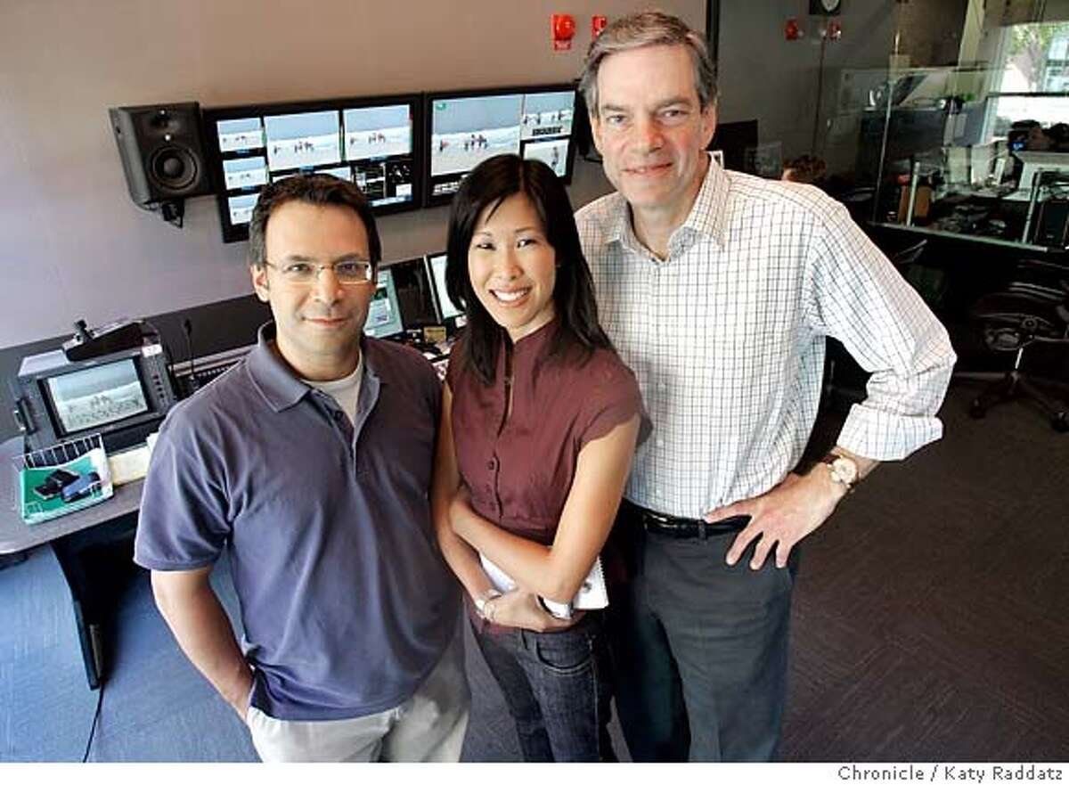 CURRENTXX_012_RAD.jpg SHOWN: L TO R: David Neuman, president of programming; Laura Ling, supervising producer of Vanguard Journalism; Joel Hyatt, CEO of the company. They're posing for this portrait in the Master Control Room. Story is about Current, a new cable TV network that is programmed using