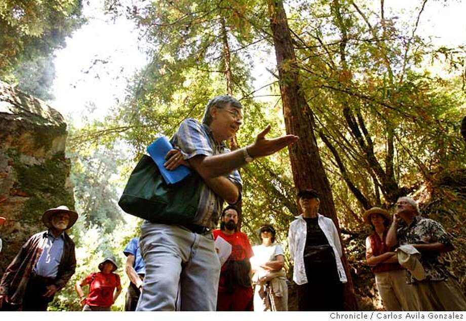 REDWOODS14_099_CAG.JPG  Dennis Evanosky, center, gives historical details to tour participants about the logging industry on Sunday, August 13, 2006. Despite its current name, Oakland was actually much better known for its redwoods. Until the early 1900s when all its redwoods were logged as part of the building boom that followed the 1906 earthquake, Oakland's famous old-growth redwoods were visible from all over the Bay Area. The famous Navigation Trees in the Oakland Hills were used as a landmark by early explorers and Gold Rush era ship captains as they entered the bay. (it helped them avoid Blossom Rock) All those trees are long gone -- but one. As part of an effort to make people more aware of the city's redwoods the Oakland Heritage Alliance is leading a hike Sunday Aug. 13 to the last remaining old-growth redwood in Oakland, which sits on a steep, remote slope near Merritt College. Photo by Carlos Avila Gonzalez/The San Francisco Chronicle  Photo taken on 8/13/06, in Oakland, Ca, USA  **All names cq (roster) MANDATORY CREDIT FOR PHOTOG AND SAN FRANCISCO CHRONICLE/ -MAGS OUT Photo: Carlos Avila Gonzalez