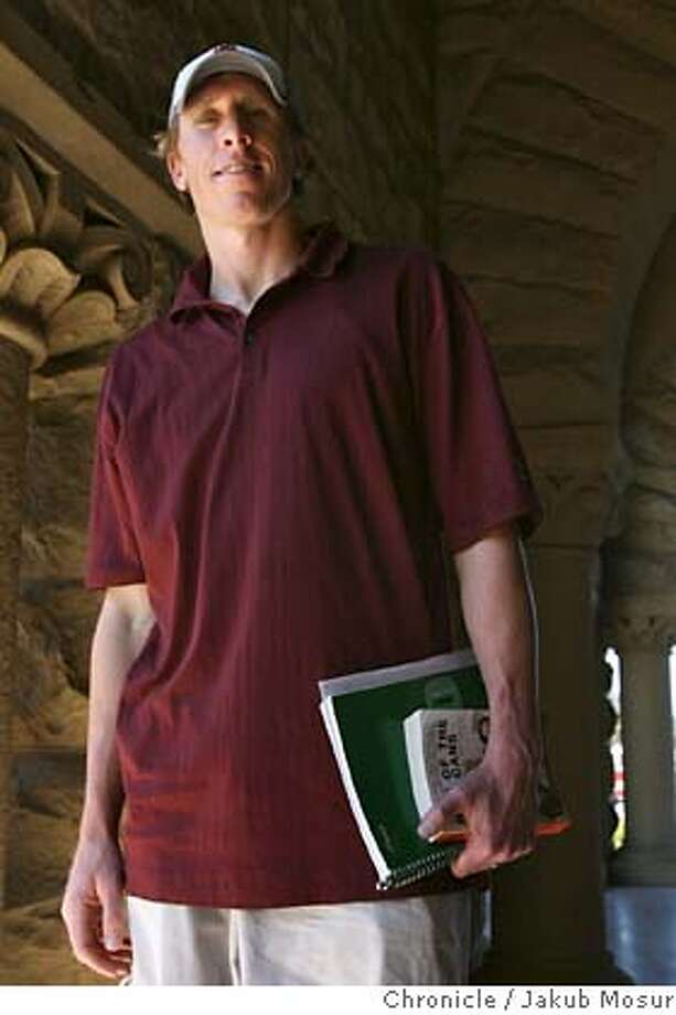 NikeCamp_05_JMM.JPG  Chad Hutchinson, former NFL and major-league baseball player, stands in a corridor at Stanford University where he has returned to complete his degree.  Event on 8/8/06 in Palo Alto. JAKUB MOSUR / The Chronicle MANDATORY CREDIT FOR PHOTOG AND SF CHRONICLE/ -MAGS OUT Photo: JAKUB MOSUR