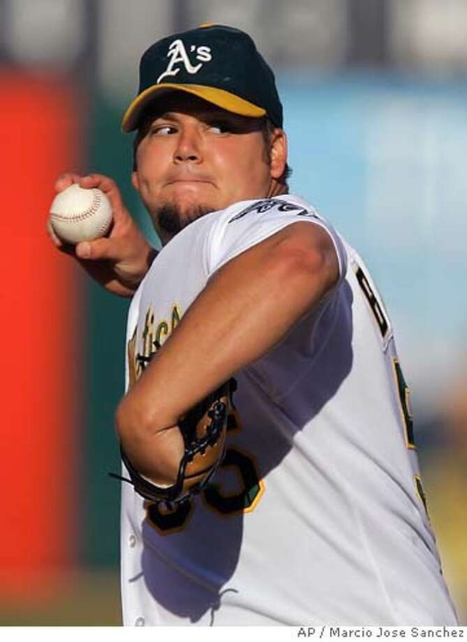Oakland Athletics starter Joe Blanton throws to the Tampa Bay Devil Rays in the first inning of a baseball game on Saturday, Aug. 12, 2006, in Oakland, Calif. (AP Photo/Marcio Jose Sanchez) Photo: MARCIO JOSE SANCHEZ